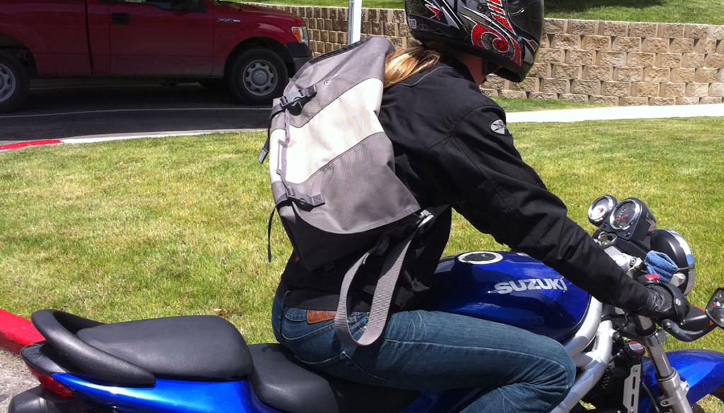 Motorcyclist with a large/medium timbuk2 messenger bag while riding an SV650