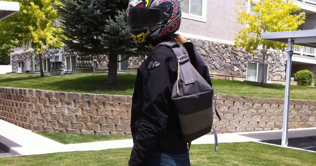 Motoryclist wearing a large/medium timbuk2 messenger bag with helmet and motorcycle jacket