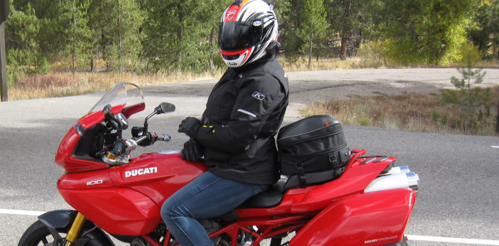 Nelson Rigg CL-1060 Tail Bag attached to the back seat of a ducati multistrada 1100