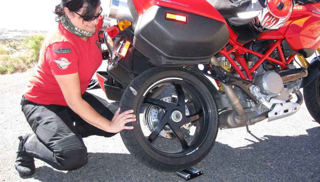 Lubing a motorcycle chain with a wheel jockey